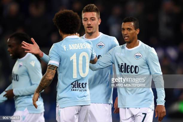 Lazio's forward from Portugal Luis Nani celebrates with teammates after scoring a goal during the Italian Serie A football match between Lazio and...
