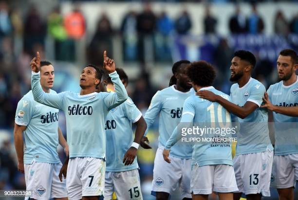 Lazio's forward from Portugal Luis Nani celebrates with teammates after scoring during the Italian Serie A football match Lazio vs Chievo at the...