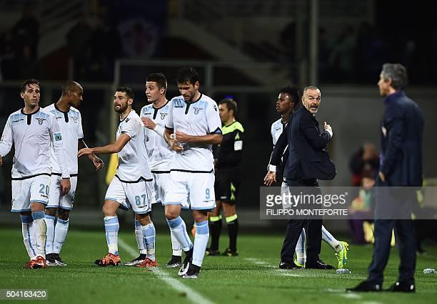 Lazio's forward from Senegal Balde Diao Keita celebrates after scoring next to Lazio's coach from Italy Stefano Pioli as Fiorentina's coach from...