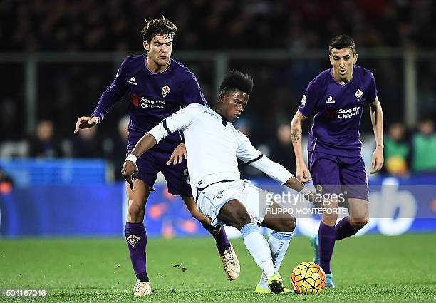 Lazio's forward from Senegal Balde Diao Keita vies with Fiorentina's defender from Spain Marcos Alonso Mendoza during the Italian Serie A football...