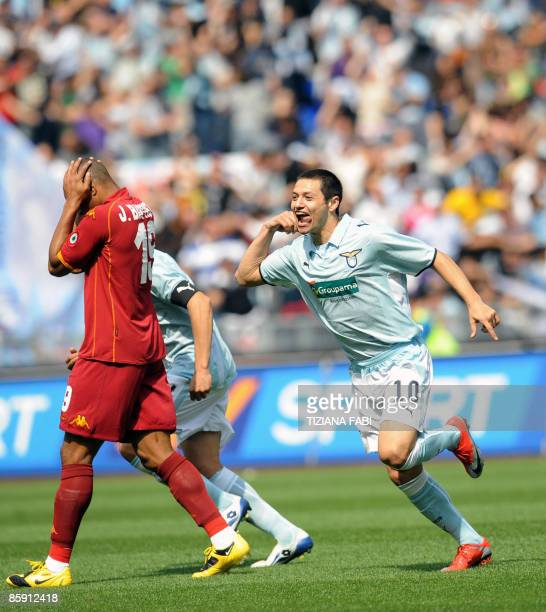 Lazio's forward Mauro Zarate celebrates after scoring against AS Roma during their Italian serie A football match on April 11 2009 at the Olympic...