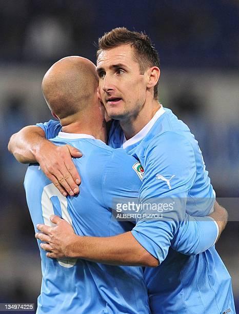 Lazio's forward Tommaso Rocchi celebrates with teammate Lazio's German forward Miroslav Josef Klose after scoring during the Italian serie A football...