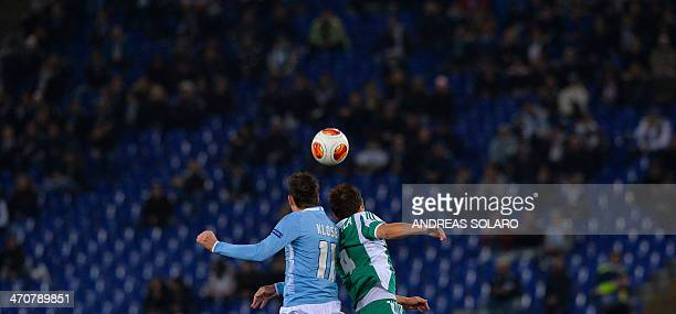 SS Lazio's German forward Miroslav Klose and PFC Ludogorets Razgrad's Finnish defender Tero Mantyla go for a header during the round of 32 UEFA...