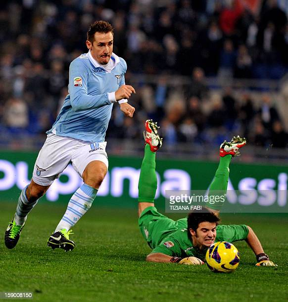 Lazio's German forward Miroslav Klose fights with Cagliari's goalkeeper Michael Agazzi during their Serie A football match at the Olympic Stadium on...