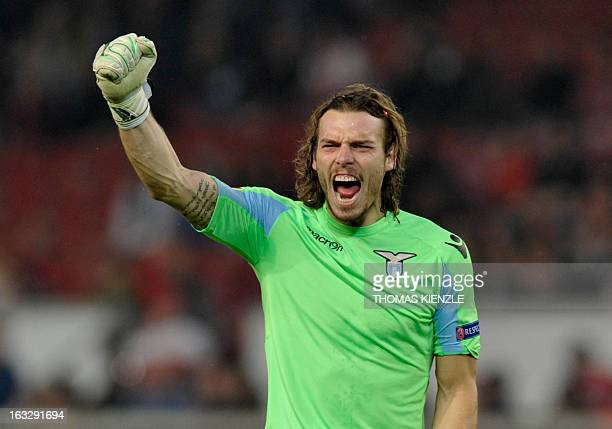 Lazio's goalkeeper Federico Marchetti reacts after his team scored the opening goal during the UEFA Europa League Round of 16 first leg football...