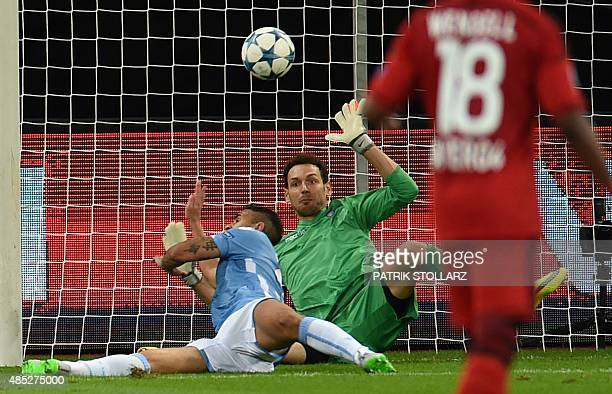 Lazio's goalkeeper from Albania Etrit Berisha vies for the ball during the UEFA Champions League playoff football match between Bayer Leverkusen and...