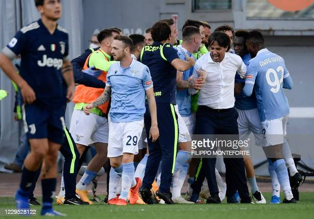 Lazio's Italian coach Simone Inzaghi celebrates with his players after scoring a goal during the Italian Serie A football match between Lazio and...