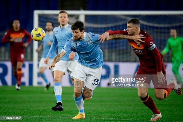 Lazio's Italian defender Francesco Acerbi and Roma's Bosnian forward Edin Dzeko go for the ball during the Italian Serie A football match Lazio Rome...