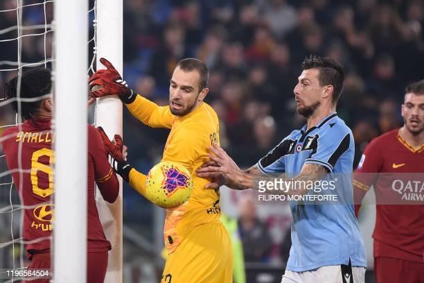 Lazio's Italian defender Francesco Acerbi celebrates after scoring an equalizer despite AS Roma's Spanish goalkeeper Pau Lopez and AS Roma's English...