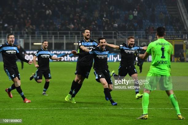 Lazio's Italian defender Francesco Acerbi Lazio's Italian forward Ciro Immobile and teammates celebrates with Lazio's Albanian goalkeeper Thomas...