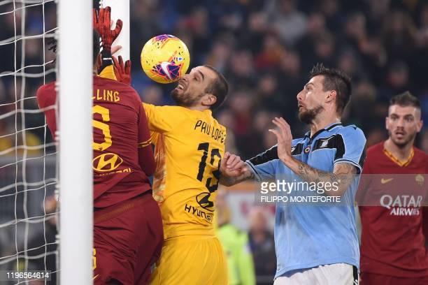 Lazio's Italian defender Francesco Acerbi scores an equalizer despite AS Roma's Spanish goalkeeper Pau Lopez and AS Roma's English defender Chris...
