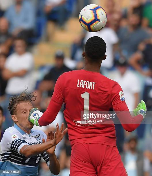 Lazio's Italian defender Lucas Leiva vies with Fiorentina's French goalkeeper Alban Lafont during the Italian Serie A football match at the Olympic...