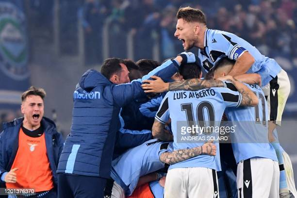 Lazio's Italian forward Ciro Immobile and teammates celebrate after Lazio scored its second goal during the Italian Serie A football match Lazio Rome...
