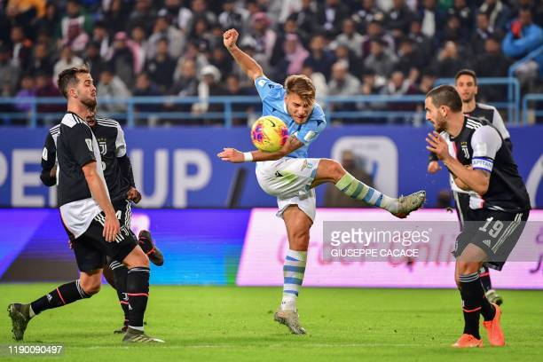 Lazio's Italian forward Ciro Immobile attempts a shot during the Supercoppa Italiana final football match between Juventus and Lazio at the King Saud...