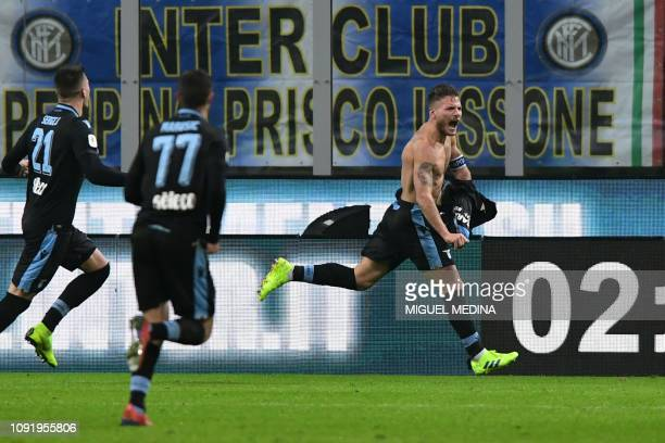 Lazio's Italian forward Ciro Immobile celebrates after openin the scoring during the Italian Tim Cup round of eight football match Inter Milan vs...