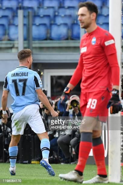 Lazio's Italian forward Ciro Immobile celebrates after opening the scoring past Spal's Albanian goalkeeper Etrit Berisha during the Italian Serie A...