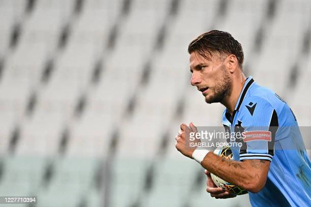 Lazio's Italian forward Ciro Immobile celebrates after scoring a goal during the Italian Serie A football match between Juventus and Lazio, on July...