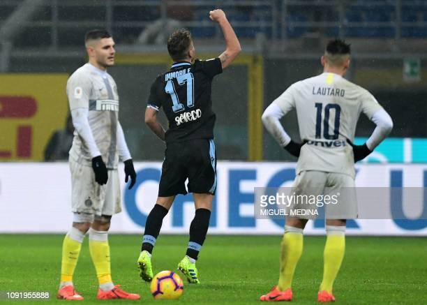Lazio's Italian forward Ciro Immobile celebrates next to Inter Milan's Argentine forward Mauro Icardi and Inter Milan's Argentine forward Lautaro...