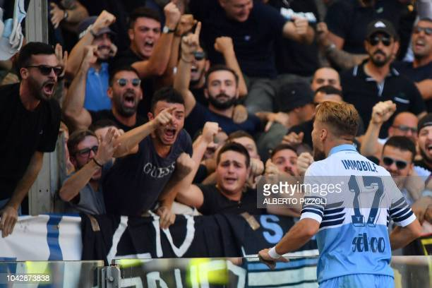 Lazio's Italian forward Ciro Immobile celebrates with fans after scoring an equalizer during the Italian Serie A football match AS Rome vs Lazio Rome...