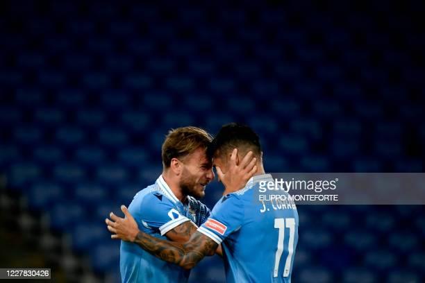 Lazio's Italian forward Ciro Immobile celebrates with Lazio's Argentine midfielder Joaquin Correa after scoring during the Serie A football match...
