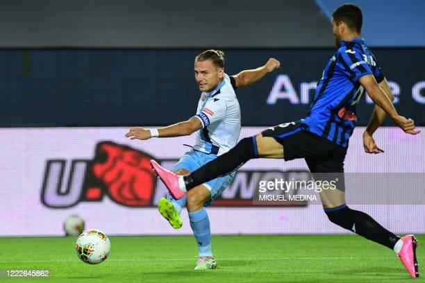 Lazio's Italian forward Ciro Immobile challenges Atalanta's Argentinian defender Jose Luis Palomino during the Italian Serie A football match...