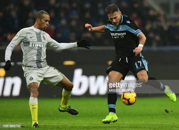 Lazio's Italian forward Ciro Immobile challenges Inter Milan's Brazilian defender Miranda during the Italian Tim Cup round of eight football match...