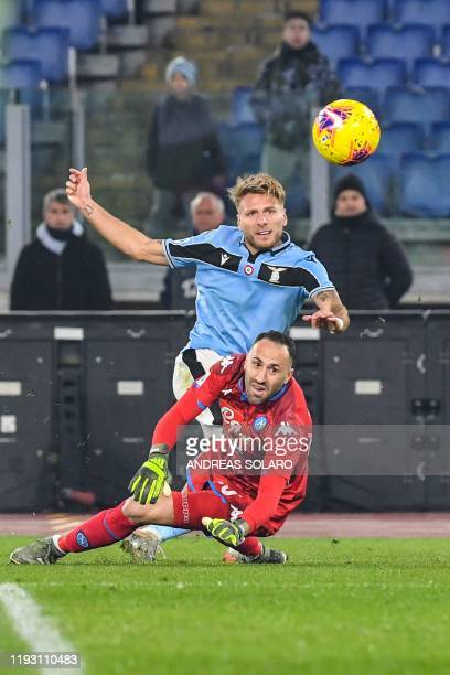 Lazio's Italian forward Ciro Immobile dribbles Napoli's Colombian goalkeeper David Ospina to shoot and open the scoring during the Italian serie A...