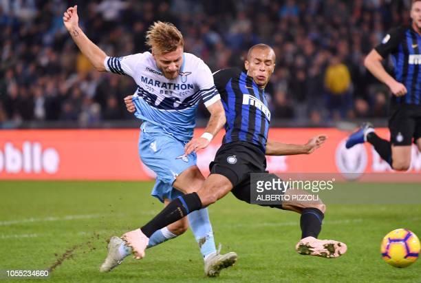 Lazio's Italian forward Ciro Immobile fights for the ball with Inter Milan's Brazilian defender Joao Miranda during Italian Serie A football match...