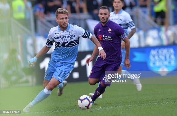Lazio's Italian forward Ciro Immobile fights for the ball with Fiorentina's Argentinian defender German Pezzella during the Italian Serie A football...