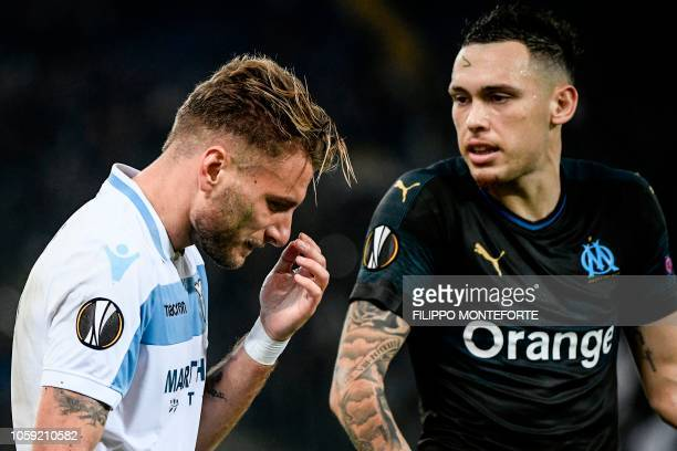 Lazio's Italian forward Ciro Immobile reacts next to Marseille's Argentine midfielder Lucas Ocampos during the UEFA Europa League group H football...