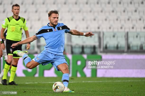 Lazio's Italian forward Ciro Immobile shoots a penalty kick and scores during the Italian Serie A football match between Juventus and Lazio, on July...