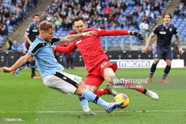 Lazio's Italian forward Ciro Immobile shoots to score his second goal past Spal's Albanian goalkeeper Etrit Berisha during the Italian Serie A...