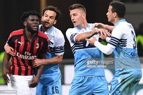 Lazio's Italian midfielder Marco Parolo and Lazio's Serbian midfielder Sergej MilinkovicSavic intervene to put an end to a scuffle between Lazio's...