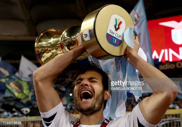Lazio's Italian midfielder Marco Parolo celebrates as he holds the Tim Cup trophy during the trophy ceremony after winning the Coppa Italia final...