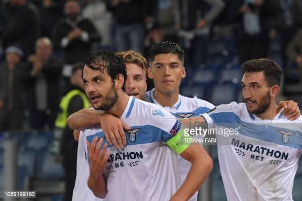 Lazio's Italian midfielder Marco Parolo celebrates with Lazio's Italian forward Ciro Immobile Lazio's Argentine forward Joaquin Correa and Lazio's...