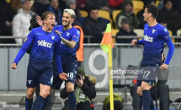 Lazios Lucas Leiva celebrates his scoring during UEFA Europa League round 16 secondleg football match FC Dynamo Kiev vs SS Lazio Rome at the...