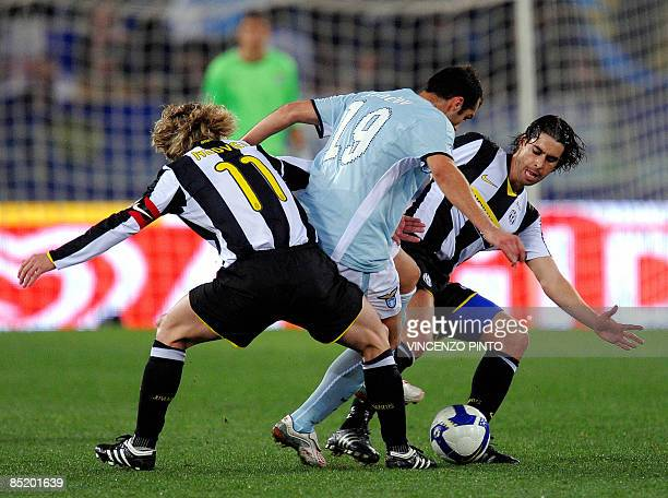 Lazio's Macedonian forward Goran Pandev figth for the ball with Juventus Czech midfielder Pavel Nedved and Juventus Portuguese midfielder Tiago...