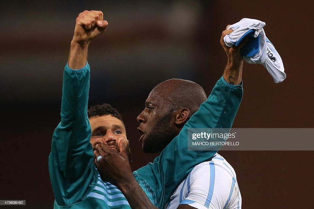 Lazio's midfielder Antonio Candreva (L) celebrates with Lazio's French defender Michael Ciani at the end of the Italian Serie A football match Sampdoria Vs Lazio on May 16, 2015 at 'Luigi Ferraris Stadium' in Genoa.