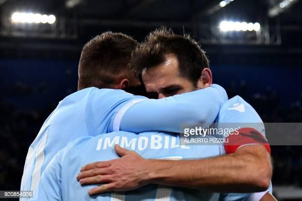 Lazio's midfielder Ciro Immobile is congratulated by teammates after scoring during the Italian Serie A football match Lazio vs Hellas Verona on...