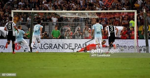Lazio's midfielder Ciro Immobile scores a penalty against Juventus's goalkeeper Gianluigi Buffon during the Italian SuperCup TIM football match...