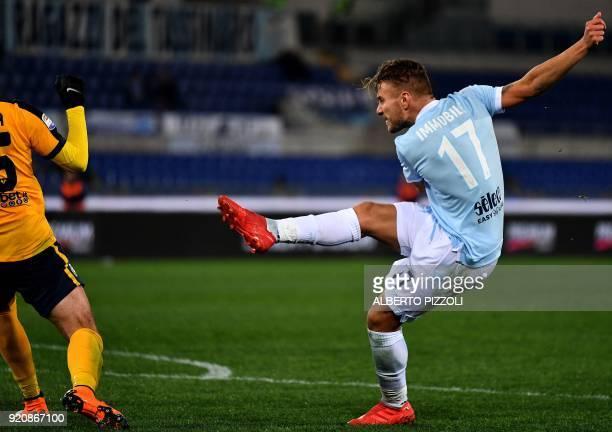 Lazio's midfielder Ciro Immobile shoots and scores during the Italian Serie A football match Lazio vs Hellas Verona on February 19 2018 at Olympic...