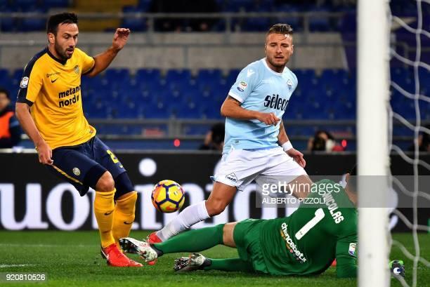 Lazio's midfielder Ciro Immobile vies with Hellas Verona's defender from Uruguay Martin Caceres and Hellas Verona's Brazilian goalkeeper Nicolas...