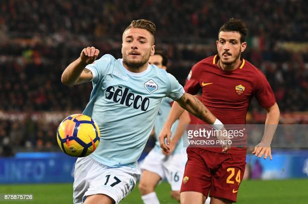 Lazio's midfielder Ciro Immobile vies with Roma's Italian midfielder Alessandro Florenzi during the Italian Serie A football match AS Roma vs Lazio...