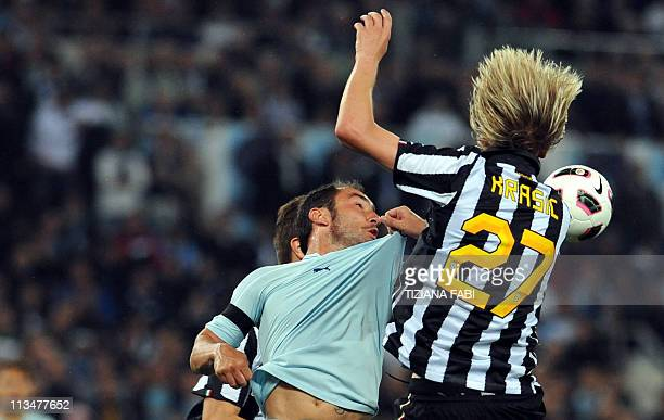 Lazio's midfielder Cristian Brocchi fights for the ball with Juventus' Serbian midfielder Milos Krasic during their Serie A football match at Olympic...