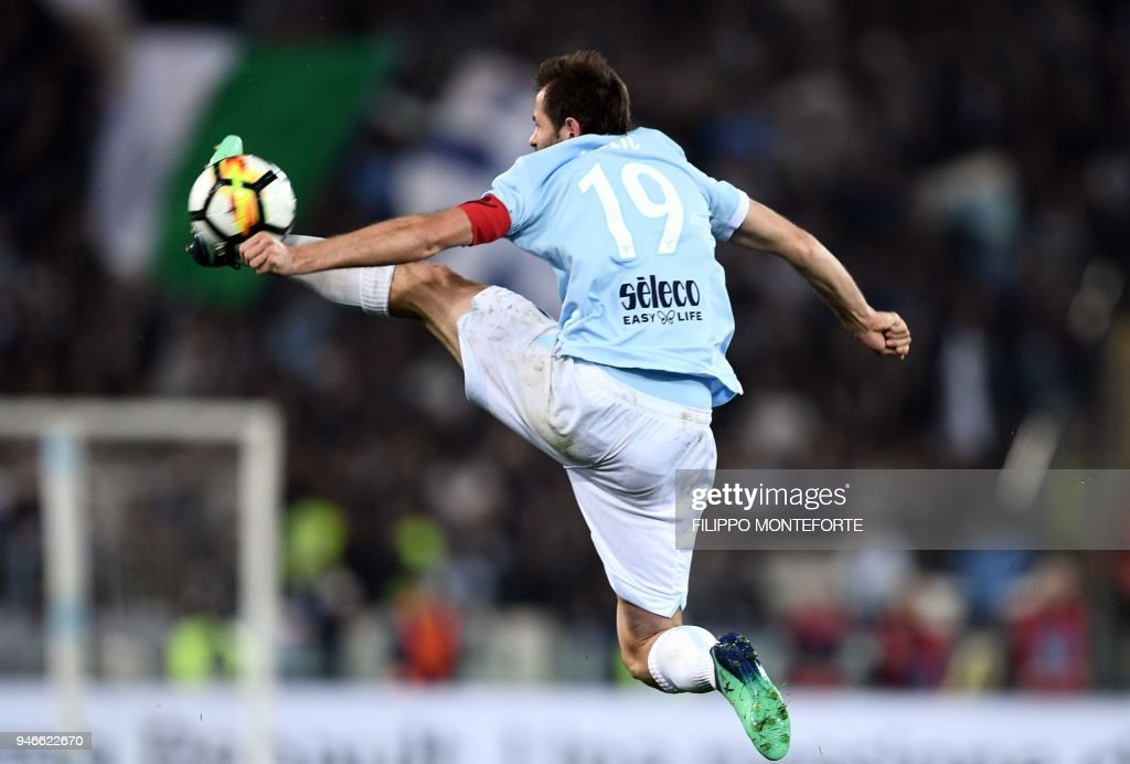 Lazio's midfielder from Bosnia and Herzegovina Senad Lulic controls the ball during the Italian Serie A football match between Lazio and Roma on April 15, 2018 at Olympic Stadium in Rome. /