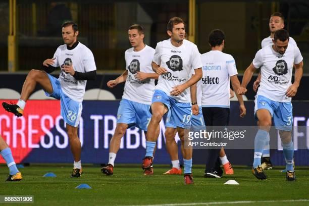 Lazio's midfielder from BosniaHerzegovina Senad Lulic and teammates wear tshirts against antisemitism showing an image of holocaust victim Anne Frank...