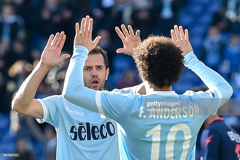 Lazio's midfielder from Bosnia-Herzegovina Senad Lulic (L) celebrates with his team mate Anderson after scoring a goal during the Italian Serie A football match between Lazio and Crotone at The 'Olympic' Comunal Stadium in Rome, on December 23, 2017. / AFP PHOTO / Andreas SOLARO