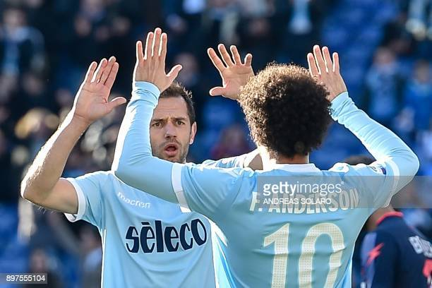 Lazio's midfielder from BosniaHerzegovina Senad Lulic celebrates with his team mate Anderson after scoring a goal during the Italian Serie A football...