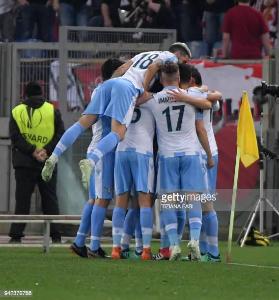 Lazio's midfielder from BosniaHerzegovina Senad Lulic celebrates with teammates after scoring during the UEFA Europa League quarter final first leg...