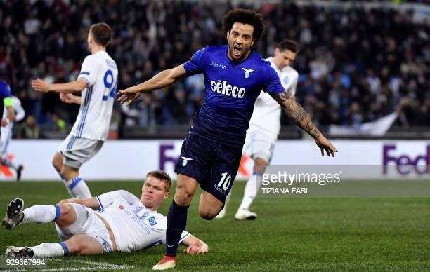 Lazio's midfielder from Brazil Felipe Anderson celebrates after scoring during the UEFA Europa League round 16 firstleg football match SS Lazio vs...